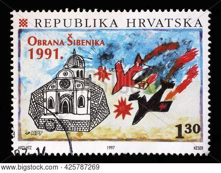 ZAGREB, CROATIA - AUGUST 29, 2014: A stamp printed in Croatia shows Air Attack on Sibenik, 1991, Defense of Sibenik in the Homeland War, circa 1997