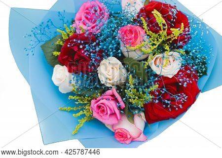 Wedding Decorative Bouquet Of The Bride Of Flowers Of Red, White And Pink Roses In Blue Paper, View
