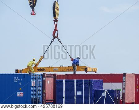 Labuan,malaysia-feb 26,2020:containers Being Unloaded From A Cargo Ship In The Labuan Port Of Labuan