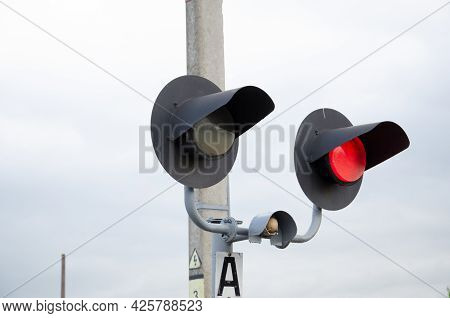 Square Grade Crossing Signal With Red Light Gate And Crossbuck At Railroad Crossing.