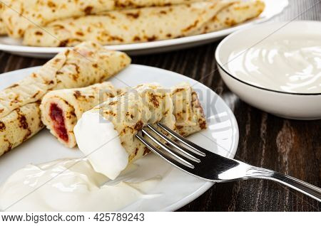 Pancake Rolls With Filling, Pieces Of Pancake With Cherry Jam, Sour Cream In White Plate, Piece Of P