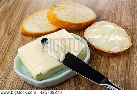 Slices Of Bread, Sandwich With Butter, Table Knife On Piece Of Butter In Spotted Light-blue Plate On
