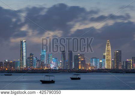 Skyline Of Shenzhen City, China At Night. Viewed From Hong Kong Border Lau Fau Shan