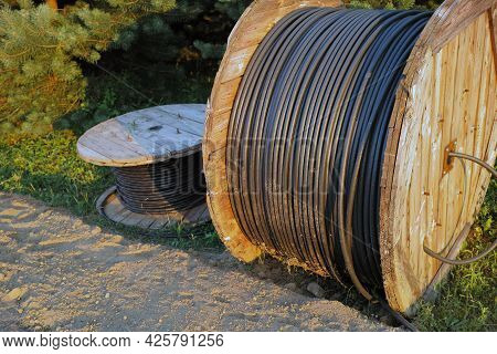 Abandoned Coils Of Electric Cable, Outdoor Sunset Shot