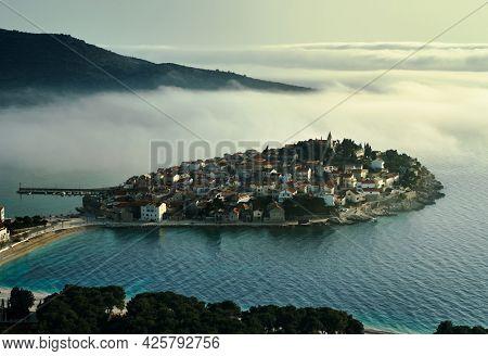 Primosten, seascape at sunset - Croatia, Adriatic sea, Dalmatia, Europe. Drone photo, clouds, mystical.