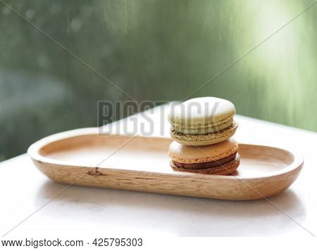 Macaron Flavor Green Tea And Coffee In Wooden Tray Plate Shape Ellipse, Dessert Snacks Afternoon On