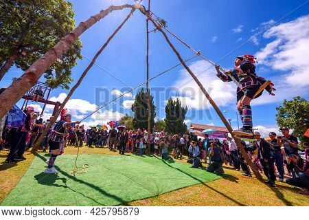 Akha Tribe Playing With The Wooden Swing On Akha Swing Festival At Doi Mae Salong. The Annual Akha S