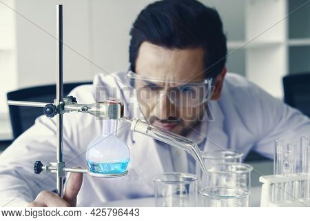 Doctor And Microbiologist With Vacuum Tubes For Samples With Covid 19 Infection Atypical Pneumonia V