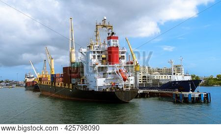 Labuan,malaysia-feb 26,2020:cargo Ships With Container In The Labuan Port Of Labuan Ft,malaysia. The