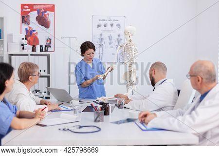 Hospital Woman Nurse Presting Bone Structure Using Body Anatomy Skeleton Discussing Medical Expertis