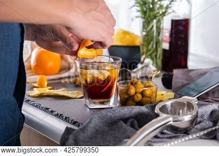 Mixologist Making Refreshing Cocktail With Vermouth At Home