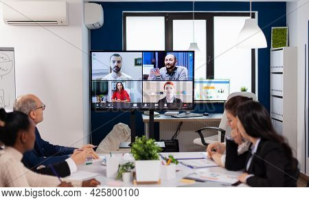 Team Working By Group Video Call Share Ideas Brainstorming Negotiating Use Video Conference. Busines