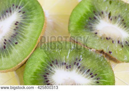 Sliced Slices Of Green Kiwi And Lemon. Slicing Berries
