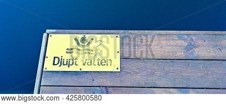 Warning Sign In Swedish Saying Deap Water