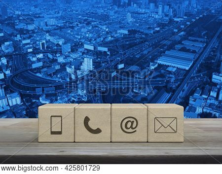 Mobile Phone, Telephone, Email Address, Mail Icon On Block Cubes On Wooden Table Over Modern Office