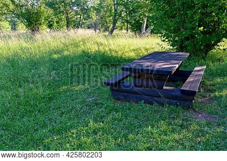 Wooden Table And Benches At Resting Area