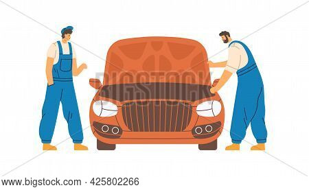 Mechanics Checking And Repairing Auto In Car Repair Service. Workers And Automobile With Hood Up. Re
