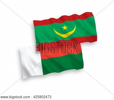 National Fabric Wave Flags Of Islamic Republic Of Mauritania And Madagascar Isolated On White Backgr