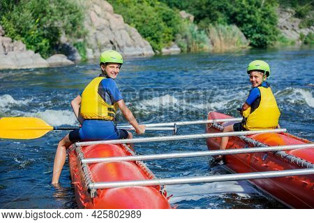 Kids And Rafting. Extreme Family Recreation And Training Of Athletes In Rafting