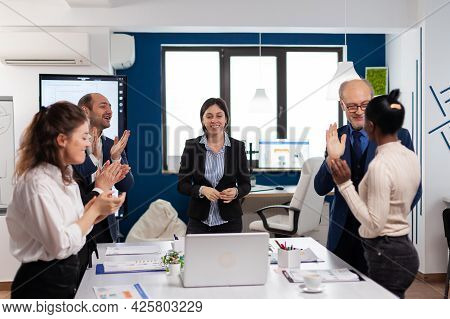 Happy Overjoyed Financial Startup Team Standing Clapping A In Conference Briefing. Multiethnical Par