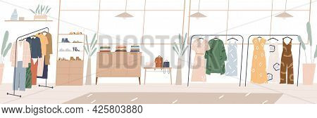 Modern Showroom Interior With Fashion Accessories And Clothes On Hanger Racks And Shelves. Inside Em