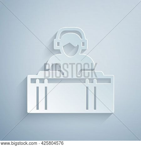 Paper Cut Dj Wearing Headphones In Front Of Record Decks Icon Isolated On Grey Background. Dj Playin