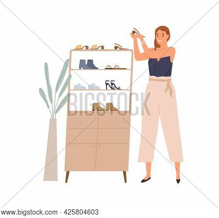 Happy Woman Holding And Looking At Fashion Pair Of Heeled Shoes And Admiring Them. Female With Perfe
