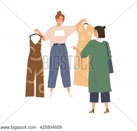 Shop Assistant Offering Choice Of Trendy Fashion Clothes To Buyer. Woman Choosing And Buying Stylish