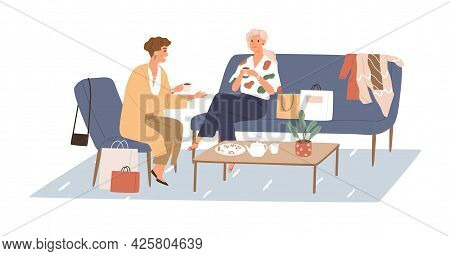 Woman Talking With Her Girlfriend In Cafe, Sitting By Coffee Table With Shopping Bags. Meeting Of Fe