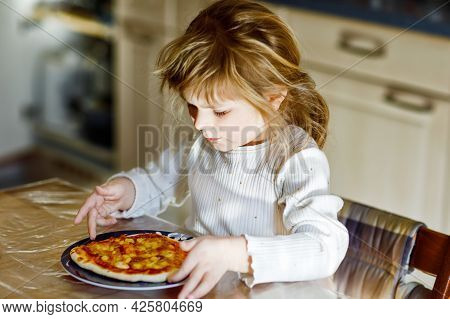 Adorable Toddler Girl Eat Italian Pizza With Vegetables And Chees. Happy Child Eating Fresh Cooked H