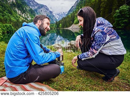 Traveling outdoor hiking and camping lifestyle in nature. Traveling in nature. Couple hikers outdoor in nature.Nature lifestyle. Lifestyle camping in Nature. Hikers camping in nature. Hiking and camping. Nature and beautiful mountain view in nature. Coupl