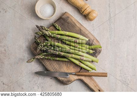 Asparagus Cooking Concept, Top Down View On A Cutting Board With Fresh Bunch Of Asparagus, Spring He