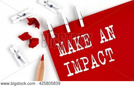 Make An Impact Text On The Red Paper With Office Tools On White Background