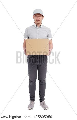 Full Length Portrait Of Postman Or Delivery Man In Uniform With Box Isolated On White Background