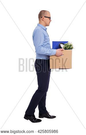 Side View Of Business Man Walking With His Belongings In Cardboard Box Isolated On White