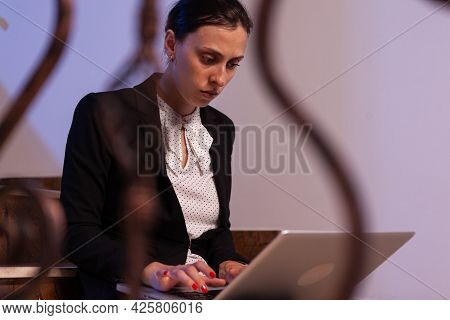 Overworked Stressed Businesswoman Working Late In The Evening On Business Deadline. Serious Entrepre