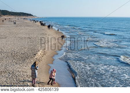 Several Of People Walking On The Beach In Spring.people Walking On The Beach In Spring.palanga,lithu