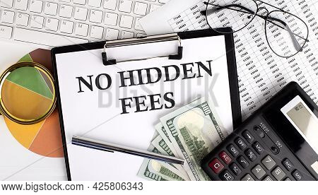 Text No Hidden Fees On Office Desk Table With Keyboard, Dollars,calculator ,supplies,analysis Chart