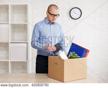 Moving Day - Fired Sad Man Packing Or Unpacking His Things In Empty Office