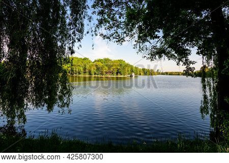 Landscape With White Boats On Herastrau Lake And Large Green Trees In King Michael I Park (former He
