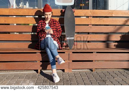 Hipster Female In Trendy Red Hat Use Smartphone Application Chatting Outdoors Send Message Check Ema