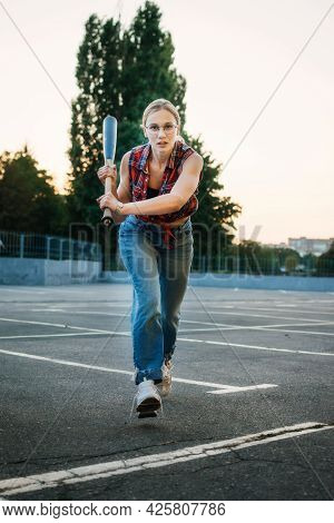 Girl Power, Feminism, Women Self-defense. Portrait Of Woman With Baseball Bat On Parking Outdoor. Yo