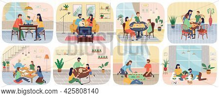 Happy People Adults And Children Sitting At Table And Playing Board Or Tabletop Games Together Scene