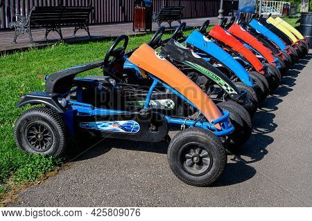 Mogosoaia, Romania - 7 May 2021: Many Colorful Large Racing Cars Available For Rent At The Children