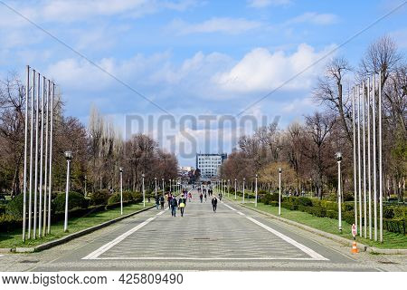 Bucharest, Romania, 20 March 2021:landscape With The Main Alley And Many Large Green Trees Near The