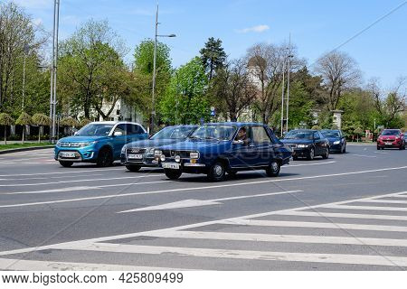 Bucharest, Romania, 24 April 2021 Old Retro Dark Blue Romanian Dacia 1300 Classic Car In Traffic In