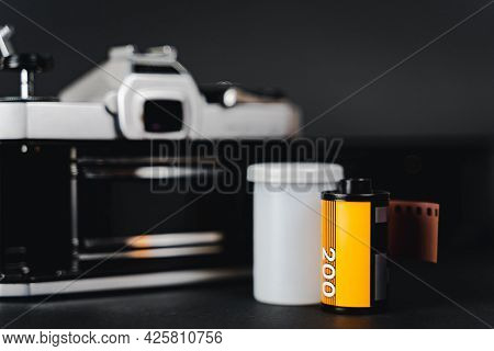 Old Slr Film Camera And A Roll Of Film On Black Background, Photography Concept.