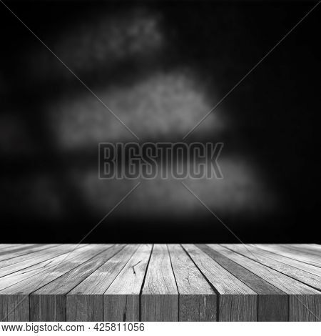 3D render of an old wooden table against a grunge wall background