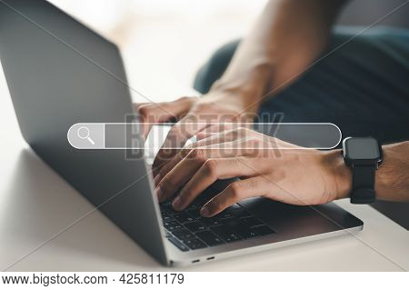 Man Using A Laptop Computer To Searching For Information With The Search Bar, Web Browser, Data Sear