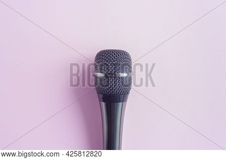 Microphone On A Colorful Pink Background Close Up. Singing, Writing Music, Karaoke Online, Creativit